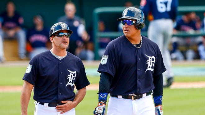 Feb 25, 2017; Lakeland, FL, USA; Tigers first base coach Omar Vizquel, left, and first baseman Miguel Cabrera walk to first base after Astros pitcher Edison Frias (67) was ejected for hitting Cabrera in the third inning at Joker Marchant Stadium.