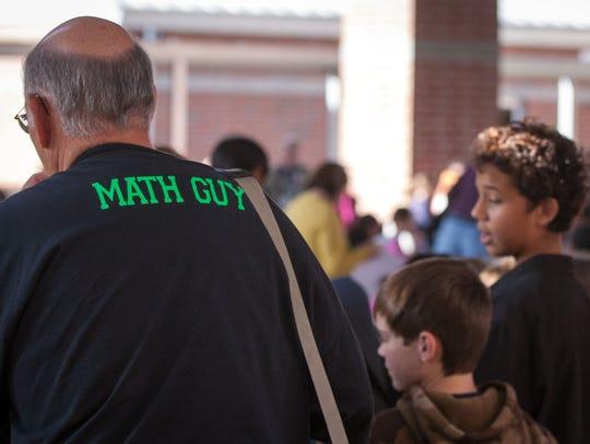 A math teacher sports his custom shirt during a previous