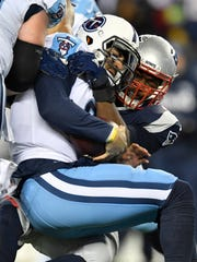 Titans quarterback Marcus Mariota (8) is sacked by