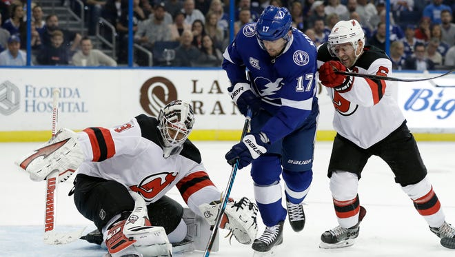 New Jersey Devils goaltender Eddie Lack (31) makes the save on a shot by Tampa Bay Lightning left wing Alex Killorn (17) during the second period of an NHL hockey game Saturday, Feb. 17, 2018, in Tampa, Fla. Defending for the Devils is defenseman Andy Greene (6).