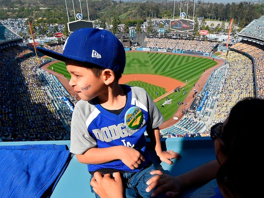 Jayson Delatorie, 5, waits fo an opening day baseball game between the Los Angeles Dodgers and the San Francisco Giants, Thursday, March 29, 2018, in Los Angeles. (AP Photo/Mark J. Terrill)