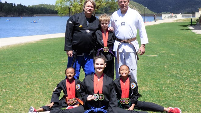 Master John Wyatt and Coach Eric Stephens pose with students Gregory Stephens, Dallas Kanesewah, MacKenzie Kanesewah and Katerina Thoksakis. The team is headed to national competition.