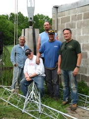 WRCR President, Dr. Alex Medakovich, first from right, and Tom Ray, the project engineer, second from left, pose with the Northeast Towers construction team.