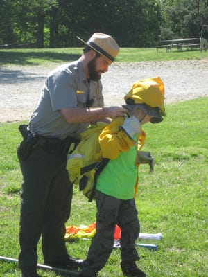A ranger at Chimney Rock State Park demonstrates a ranger's job during a recent Boy Scout Day at the Park. This Friday, the park will celebrate World Ranger Day in honor of rangers who have been killed or injured on the job around the world.