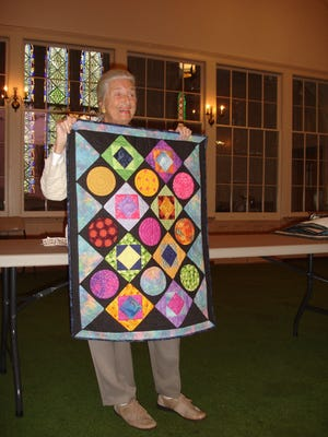 Harriet Weber displays a quilt at the November meeting of Greenwich Tea Burning Chapter of the Daughters of the American Revolution.