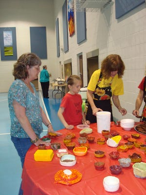 Holly Strayer, far right, art teacher at Chambersburg Area Senior High School, scoops ice cream into handmade bowls at the first Soup for Soul event, in 2012.