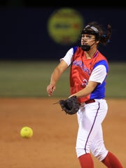 Gregory-Portland's Sydney Ouellette pitches in the