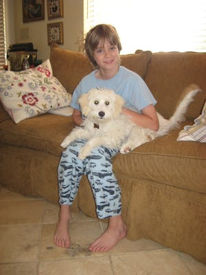 Sawyer was 9 when we brought home the puppy he named Widdle Warrick.