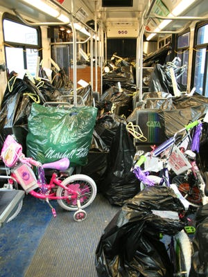 This year, CATA's Operation Santa Program will fill the bus with holiday gifts for 35 children from 22 families at Wexford Elementary School.