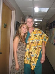 Drs. Vanessa Johnson and Larry Bishop, seen after Johnson returned from Ghana in 2008, go way back – and now, both are dermatologists with Health First.