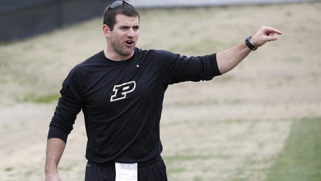 Wide receivers coach Gerad Parker with instructions for the players before the start of a drill during spring football practice Tuesday, April 7, 2015, at the Bimel Practice Complex on the campus of Purdue University.