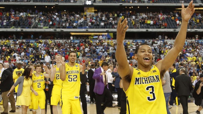 Michigan's Trey Burke celebrates the team's 79-59 victory over Florida in the NCAA tournament Elite Eight on March 31, 2013.