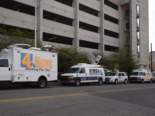 News vehicles are parked on Cherry Street outside the Hamilton County Courts Building on Wednesday, March 30, 2016, during jury selection in the Vanderbilt rape case.