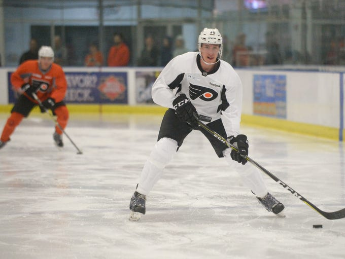 Forward Isaac Ratcliffe skates with the puck during