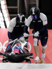 Driver Nick Cunningham and Hakeem Abdul-Saboor of the United States starts their third heat during the two-man bobsled final at the 2018 Winter Olympics in Pyeongchang, South Korea, Monday, Feb. 19, 2018. (AP Photo/Wong Maye-E)