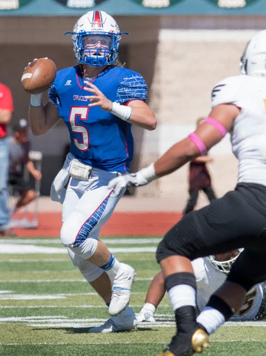 Bulldawgs quarterback Payton Ball looks downfield for