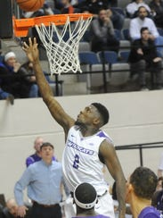 ACU's B.J. Maxwell drives to the basket over the Stephen