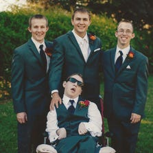 Keith, left, Cody and Josh Gibson surround their brother, Jacob, during a portrait taken at Cody's wedding. Parenting Network is putting on a family festival for children with special needs and their families Oct. 4 at Rawhide Stadium.