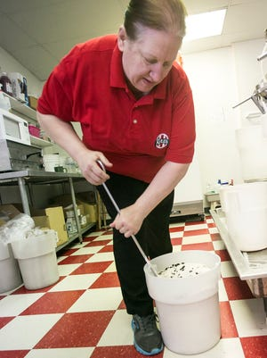 Store manager Christa Lark, mixes a batch of cookies & cream ice Tuesday, March 1, 2016, at Rita's Italian Ice in Springettsbury Township. Rita's will be giving away free ices to celebrate the first day spring March 20. Amanda J. Cain photo