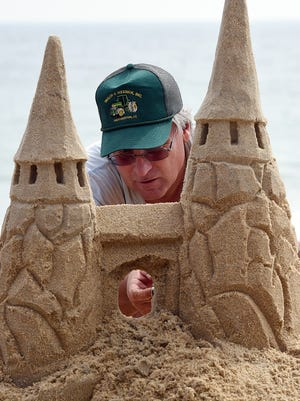 Andy West from Harrington makes a castle as The 38th Annual Rehoboth Beach-Dewey Beach Chamber of Commerce Sandcastle Contest was held on Saturday, Sept. 10, 2016 at a new location on the south end of the beach near Funland under hot weather conditions.  Participants worked to create different castles and sculptures in the sand for judging in the late afternoon at which time trophy's ail be given out.