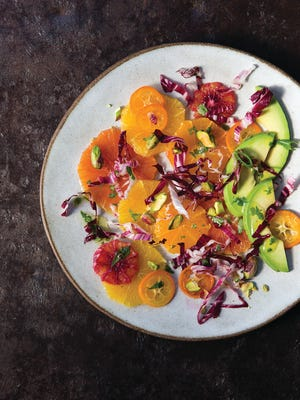 Citrus and avocado salad is dressed with a lime-cumin vinaigrette.