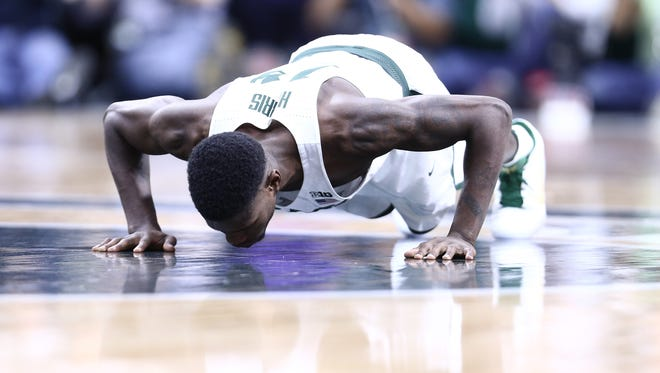 Eron Harris of the Michigan State Spartans kisses the Spartans logo on senior day late in the second half of MSU's 84-74 win over the Wisconsin Badgers at the Breslin Center on Feb. 26, 2017 in East Lansing.