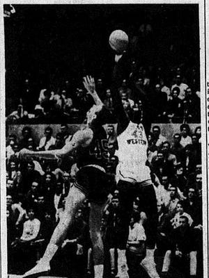 1965: LATTIN SHOOTS: - Texas Western's David Lattin goes up to shoot against Fresno State. Fresno's Lonnie Hughey (45) goes up with Lattin in an attempt to block the shot. The Miners defeated Fresno, 76-73 Friday night and took an 83-65 victory in Saturday night's game.