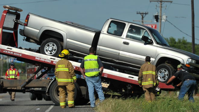 Wichita West Volunteer firefighters work the scene of an accident on U.S. Highway 82 just west of Wichita Falls Friday afternoon. A Department of Public Safety Trooper on the scene said one person was transported to the hospital with non-life-threatening injuries. Wichita County deputies were dispatched to help with traffic control.