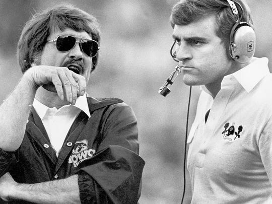 Dan McCarney, right, served as an assistant coach under Hayden Fry at Iowa.