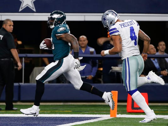 Philadelphia Eagles' Nigel Bradham (53) scores a touchdown after recovering a Dallas Cowboys' Dak Prescott (4) fumble in the second half of an NFL football game, Sunday, Nov. 19, 2017, in Arlington, Texas. (AP Photo/Ron Jenkins)