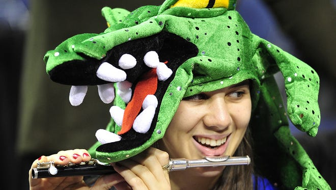Florida piccolo player Kelsea Rose wears her gator hat as they warm up before their game against Alabama in the 2015 SEC Men's Basketball Tournament at Bridgestone Arena Thursday March 12, 2015, in Nashville, Tenn.