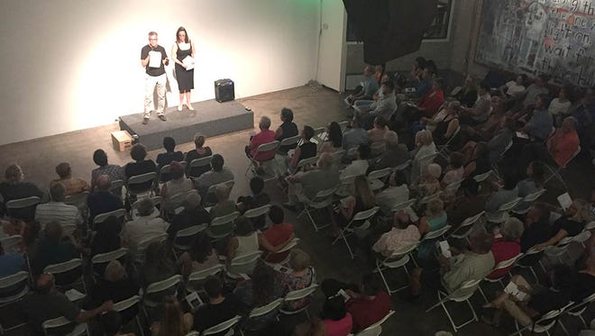 Arizona Republic reporter Daniel González is introduced by Megan Finnerty, director of the Storytellers Brand Studio, during a Storytellers event focusing on the U.S.-Mexico border.