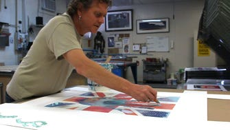 Rick Allen, drummer for the rock band Def Leppard, works on a piece of art in his studio.