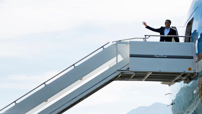 US President Barack Obama boards Air Force One at Palm Springs International Airport February 17, 2014 in Palm Springs, California.