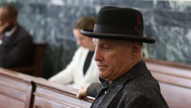 Cincinnati restaurateur Jeff Ruby sitting in the media overflow room at the Hamilton County Courthouse Thursday. Ruby said he was there in support of the DuBose family.