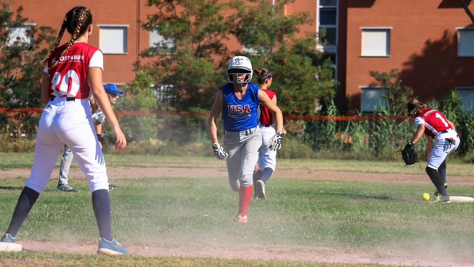 Shippensburg softball player Alexis Alleman, center,
