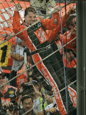 FILE – Tony Stewart was given a piece of the IMS fence he climbed after winning the 2005 Brickyard 400.