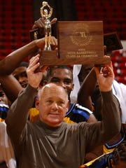 Wi-Hi coach Butch Waller hoists the 2A state title