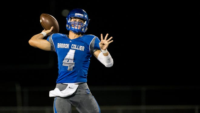 Barron Collier quarterback Jack Bueltel drops back to throw during the first quarter of action against Dixie Hollins at Barron Collier High School Friday, August 19, 2016 in Naples. Barron Collier led 14-0 at the end of the first.
