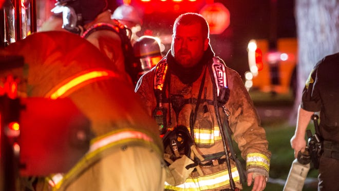 Firefighters attempt to take down flames inside a residential structure fire on April 11 at 315 E. South Street. One person was taken to IU Health Ball Memorial Hospital  in serious condition after the multi-family home caught fire.