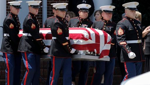 United States Marines carry the casket of U.S. Marine Corps Staff Sgt. David Wyatt after his funeral service July 24, 2015, in Hixson, Tenn. Wyatt was one of five servicemen killed last July by gunman Mohammad Youssef Abdulazeez.