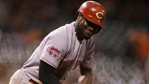 Cincinnati Reds' Brandon Phillips bats against the San Francisco Giants in the ninth inning of a baseball game Wednesday, Sept. 16, 2015, in San Francisco. (AP Photo/Ben Margot)