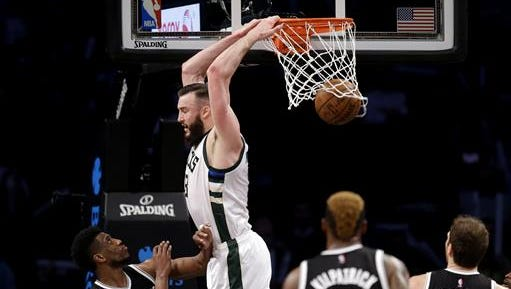 Christ School alum Miles Plumlee agreed to a four-year, $52 million deal with the Milwaukee Bucks on Monday.