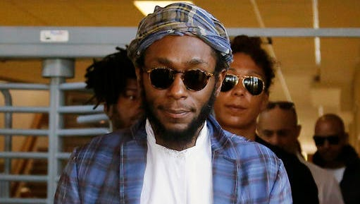 FILE - In this March 24, 2016 file photo, American actor and musician Yasiin Bey, also known as Mos Def, leaves the Bellville Magistrates' Court in Bellville, South Africa. Bey, who announced he was retiring from the music business after getting into a legal fight in South Africa, will take the stage at the Apollo Theater on Dec. 21 and then play the Kennedy Center from Dec. 31-Jan. 2. The 42-year-old rapper and actor was charged with trying to leave South Africa while using a passport not recognized by that country.