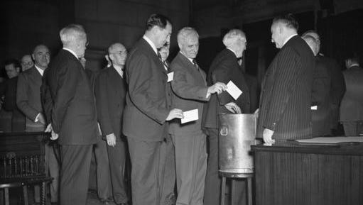 FILE - In this Dec. 16, 1940 file photo, New York State electoral college members cast votes at the state capital in Albany, N.Y. The Founding Fathers set up the Electoral College to ensure a well-informed, geographically diverse group of electors would choose the nation's presidents. That sounds rational _ and sometimes it even works. But the history of the Electoral College also includes tales of tie votes, hanging chad, conniving politicians and intrigue.