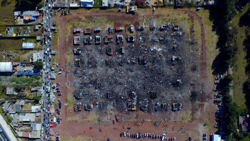 A fireworks market lays in ruins one day after an explosion at the San Pablito Market in Tultepec on the outskirts of Mexico City, Wednesday, Dec. 21, 2016. The market was especially well stocked for the holidays and bustling with hundreds of shoppers when a powerful chain-reaction explosion ripped through its stalls Tuesday, killing and injuring dozens.
