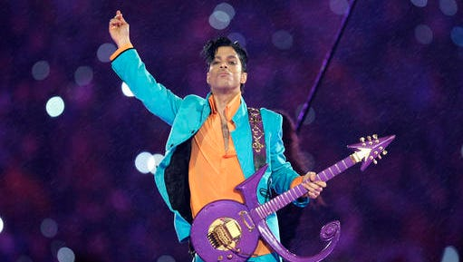 FILE - In this Feb. 4, 2007, file photo, Prince performs during the halftime show at the Super Bowl XLI NFL football game at Dolphin Stadium in Miami. Prince's estate has signed a deal with Global Music Rights, founded by entertainment industry powerhouse Irving Azoff, to represent songs written by the icon. Prince died at his home in Chanhassen, Minn. on April 21, 2016 at the age of 57. (AP Photo/Chris O'Meara, File)