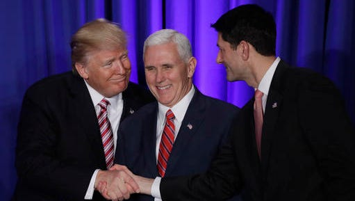 President Donald Trump, accompanied by Vice President Mike Pence, shakes hands with House Speaker Paul Ryan of Wis., Thursday, Jan. 26, 2017,  prior to speaking at the Republican congressional retreat in Philadelphia. (AP Photo/Matt Rourke)