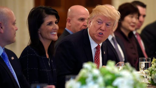 President Donald Trump, sitting next to U.S. Ambassador to the UN Nikki Haley, speaks during a working lunch with ambassadors of countries on the United Nations Security Council and their spouses, Monday, April 24, 2017, in the State Dining Room of the White House in Washington.