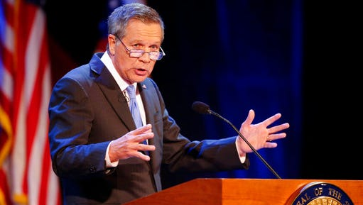 """FILE-  In this April 4, 2017 file photo, Ohio Gov. John Kasich delivers his State of the State address at the Sandusky State Theatre in Sandusky, Ohio. Kasich's """"Two Paths: America Divided or United"""" is being published Tuesday, April 25. The book reflects on Kasich's career, his run for the presidency and his views on a wide range of issues, from media coverage of politics to voting rights."""
